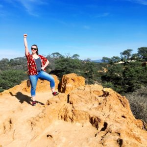 see heather smile, top of the world, top of mountain, top of hill, brown, green, blue, red, woman, fist pump, nature