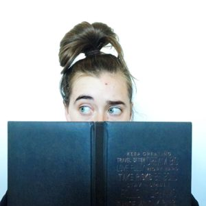 nose in a book, see heather smile, open book, reading, fiction, self-help, non-fiction, raised eyebrow