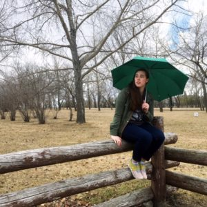 see heather smile, sitting on fence, umbrella,