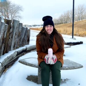 see heather smile, travel mug, winter, winter coat, brown coat, woman, brown hair, park bench, snow