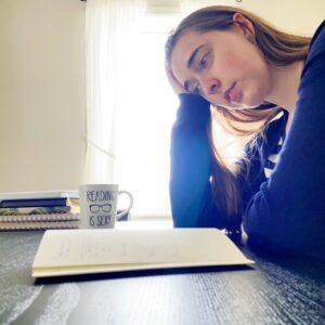 see heather smile, writing, black table, author, notebook, open notebook, desk space, office space